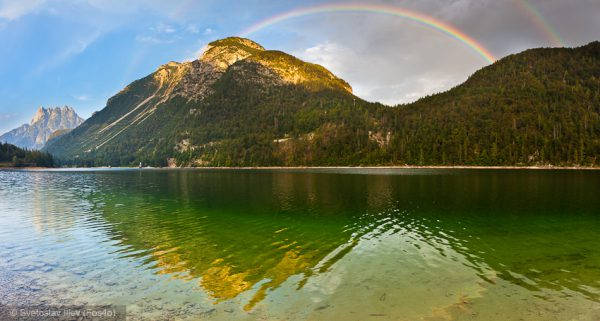 Rainbow over Lago di Predil, Alps, Italy